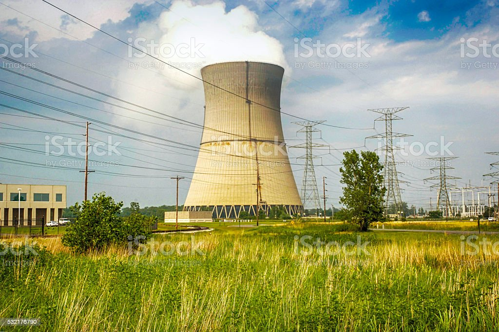 Power Station cooling Tower emitting steam stock photo