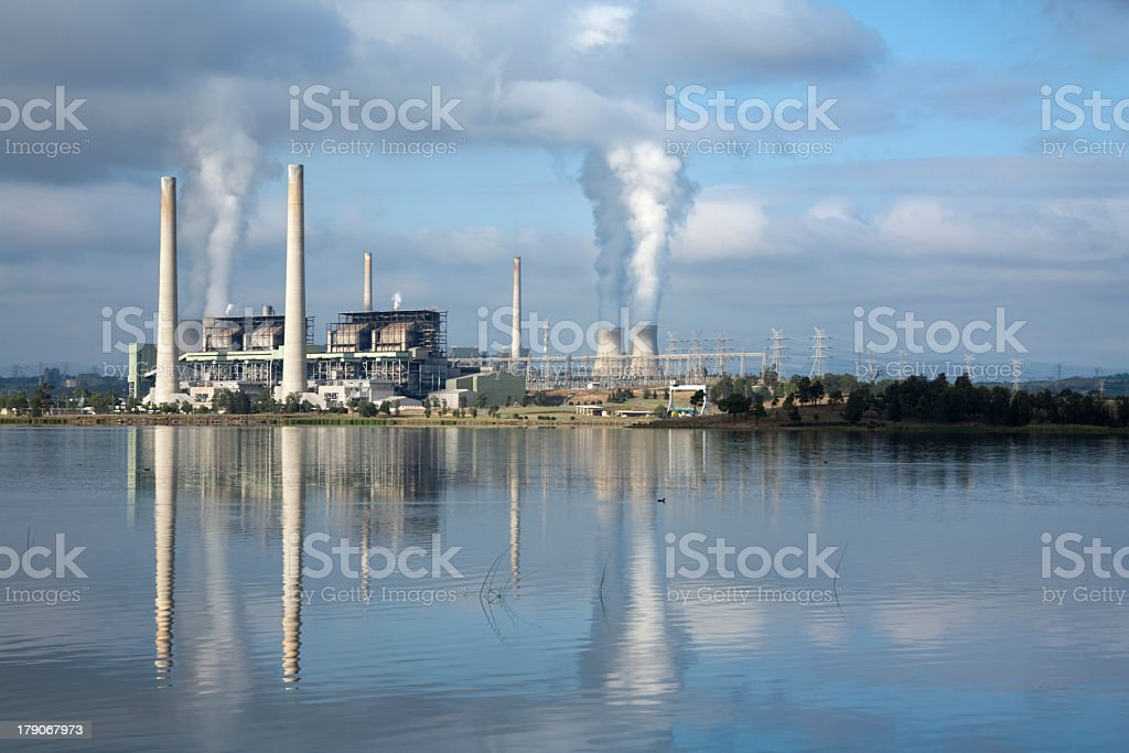 Power station in Australia reflecting in the lake stock photo
