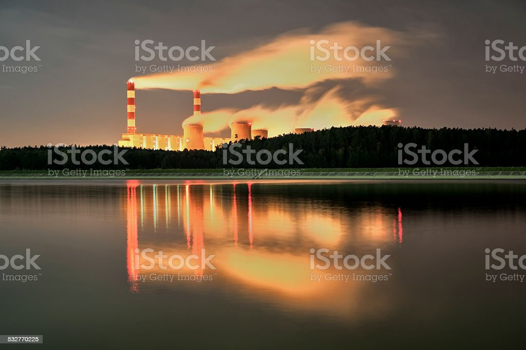 Power station, spinning pathways at night with smoke stock photo