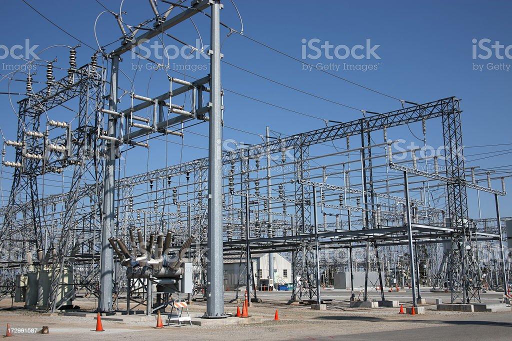 Power station with little orange cones around stock photo
