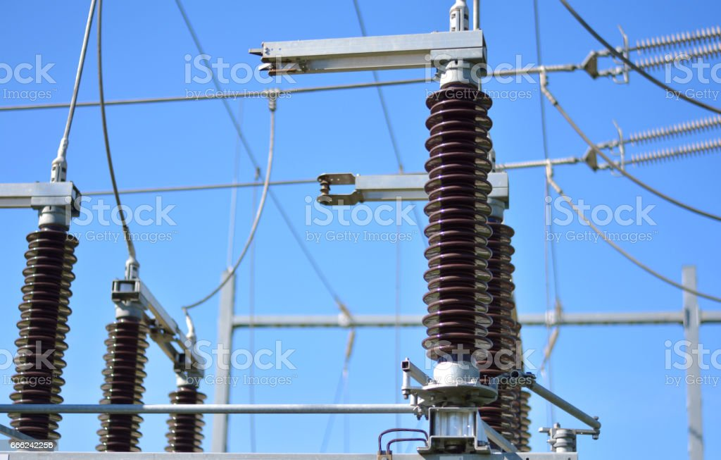 Power substation with insulators, power lines and blue sky stock photo