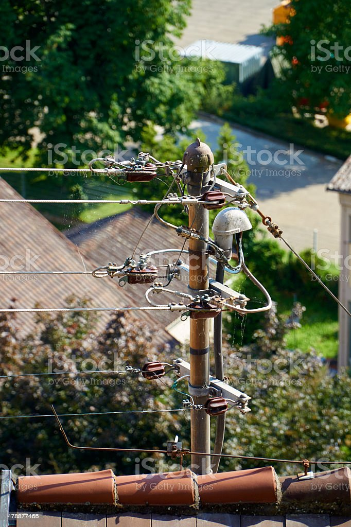 Power supply to the house roof stock photo