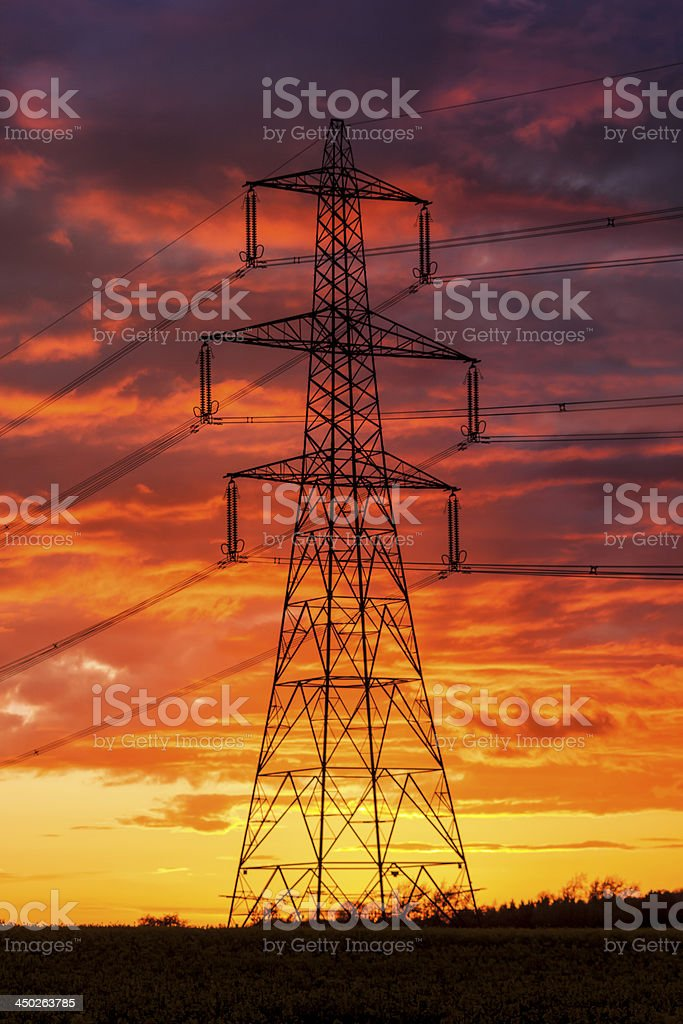 Power supply under apocalyptic looking skies stock photo