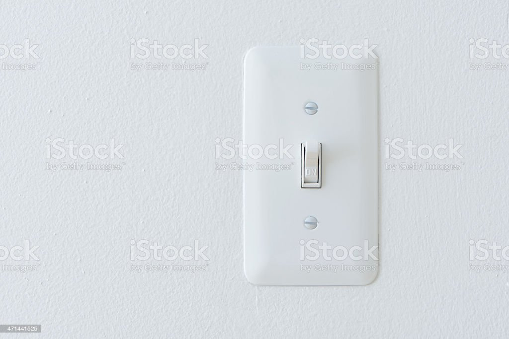 Power Switch Against White Wall: 'On' Position stock photo