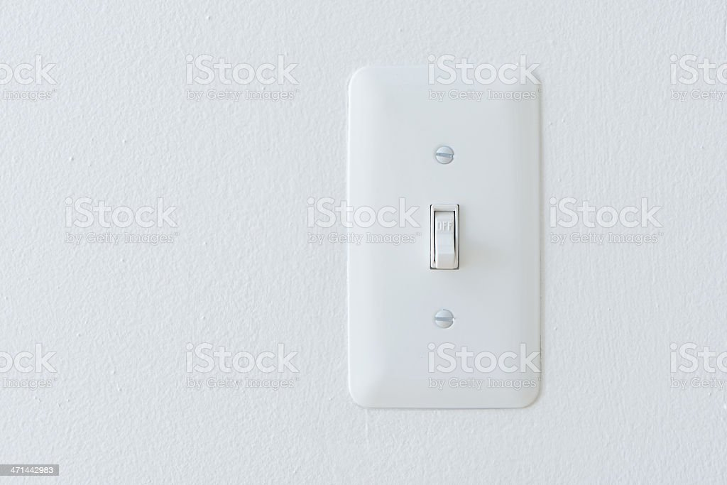 Power Switch On White Wall: 'Off' Position stock photo