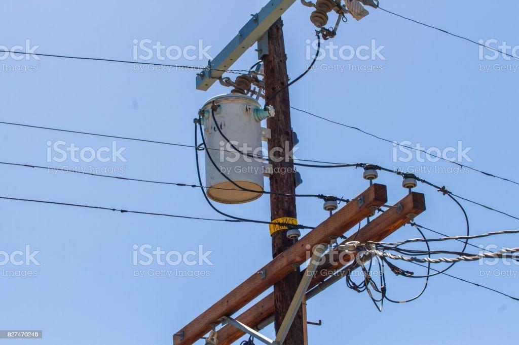 Power transformer on a pylon stock photo