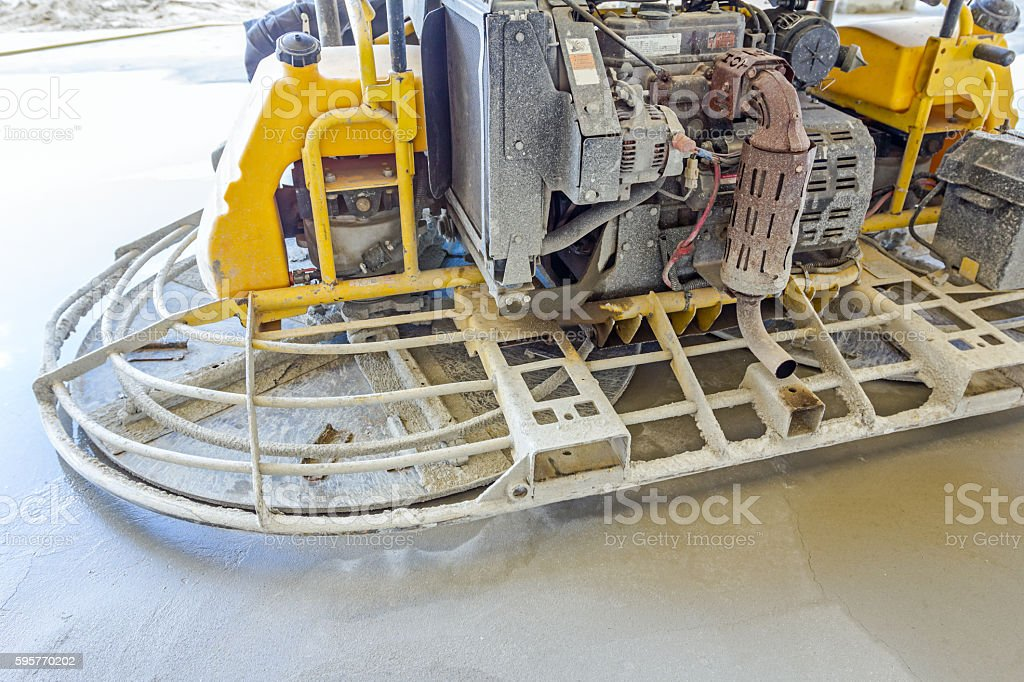 Power trowel machine for finishing surface concrete leveling stock photo