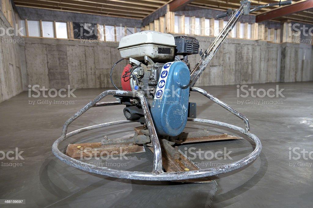 Power Trowel on Concrete Basement Floor stock photo