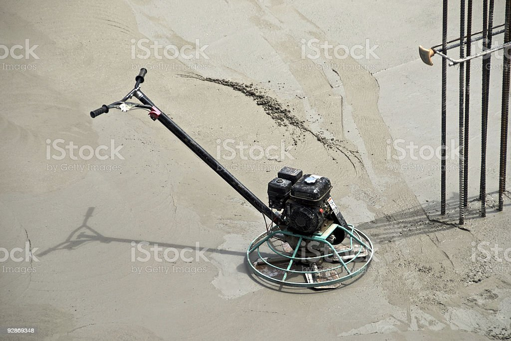 Power Trowel on drying concrete stock photo