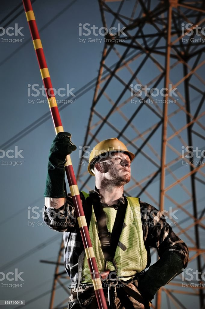 Power utility worker taking a break at dusk royalty-free stock photo