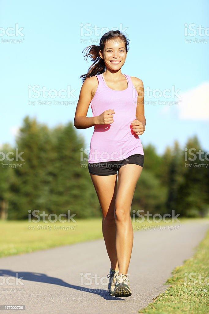 Power walking woman in park stock photo