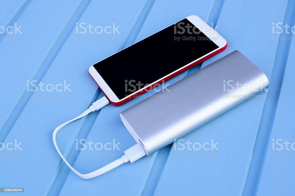 Powerbank charging smartphone stock photo