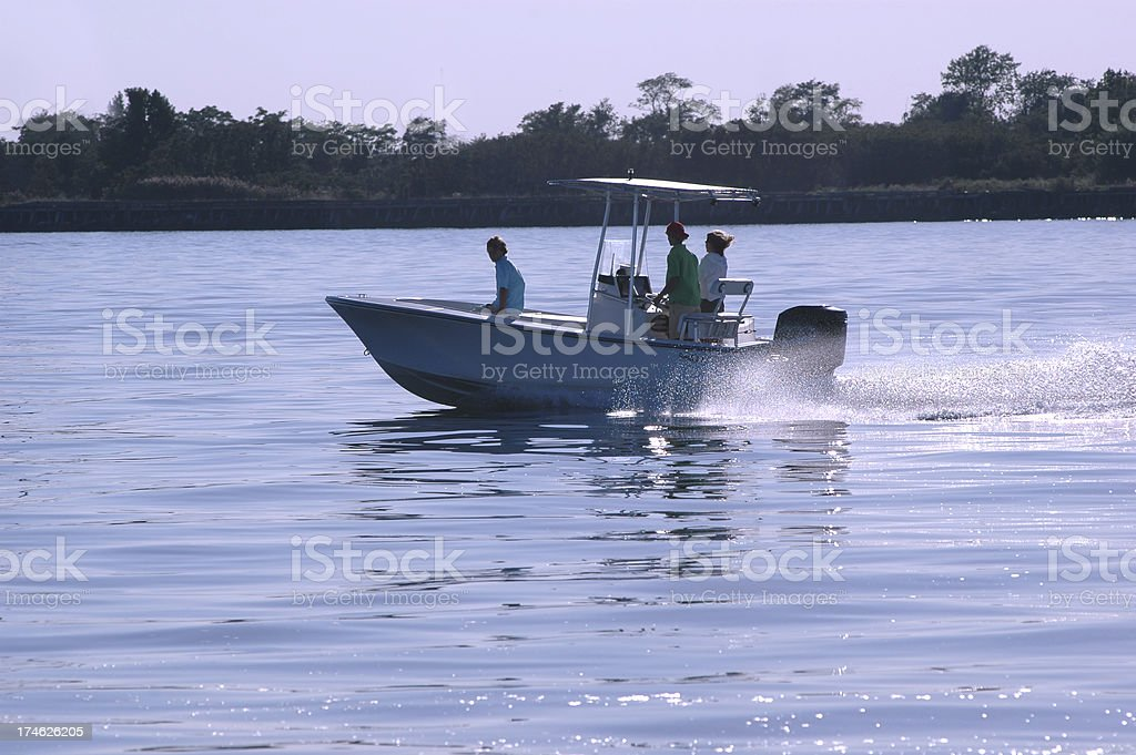 powerboat at dusk stock photo