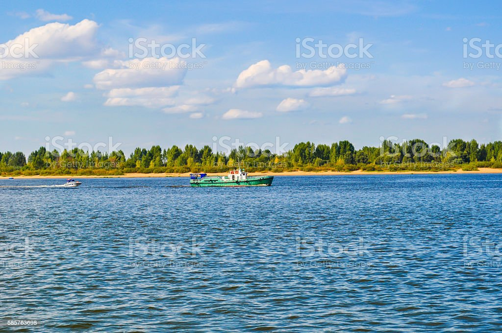 Powerboat floats on the river stock photo