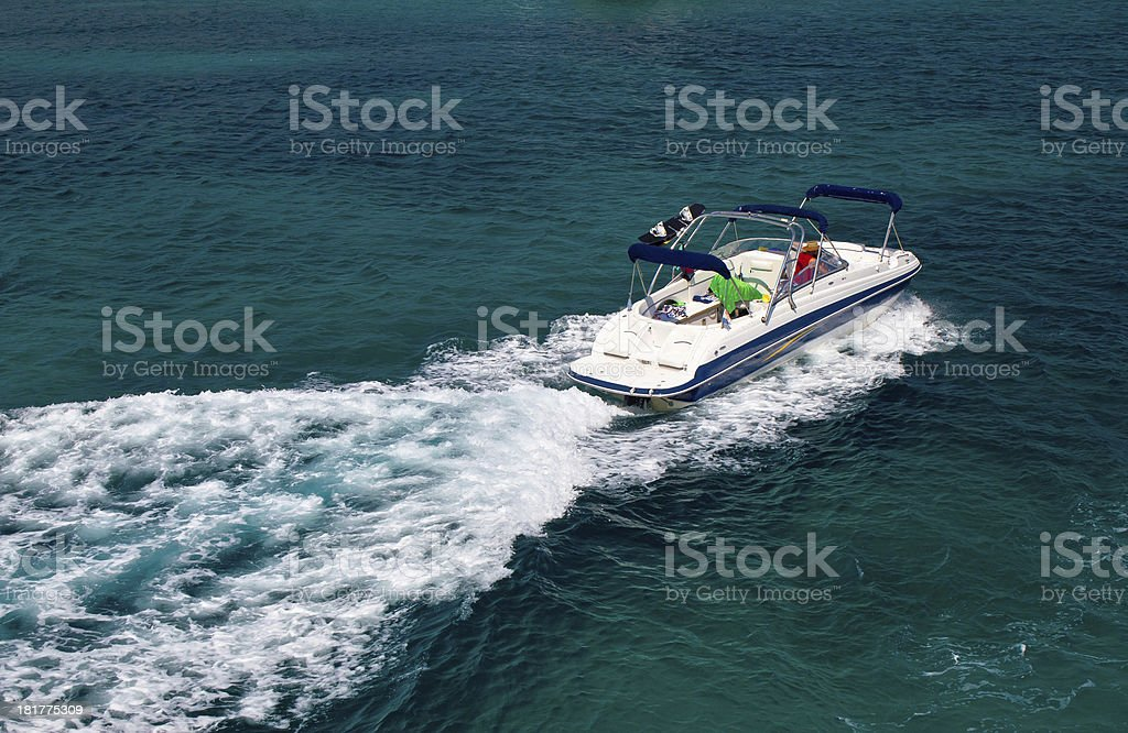 Powerboat on blue open water royalty-free stock photo