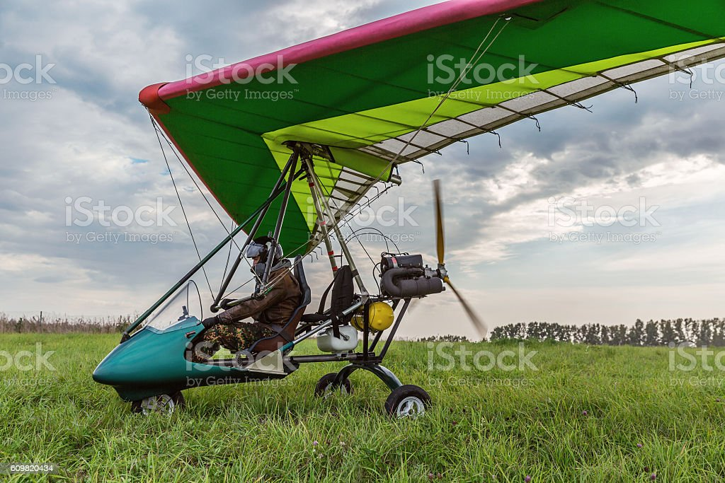 Powered paragliding at the flying field with green grass. stock photo