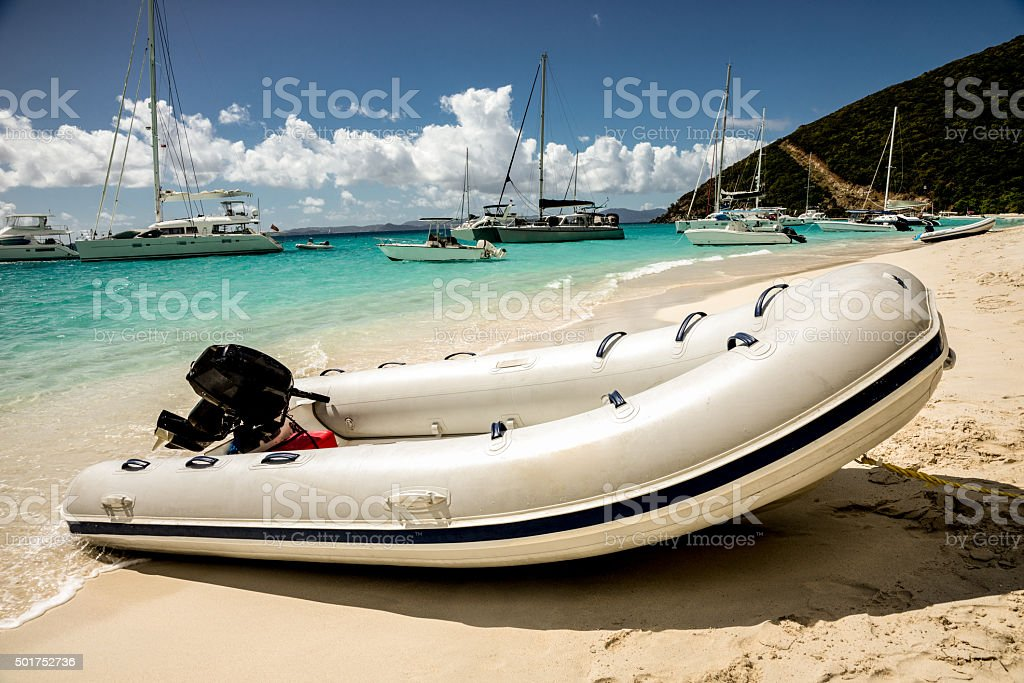Powered Rubber Raft on a Tropical Beach stock photo