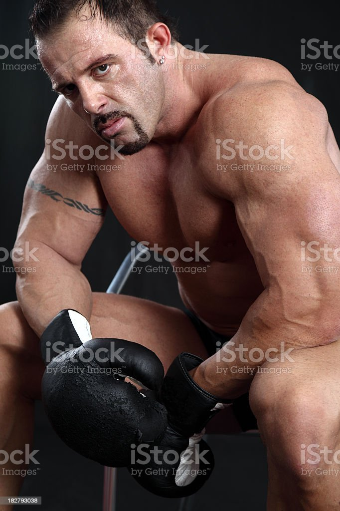 Powerful boxer between rounds royalty-free stock photo