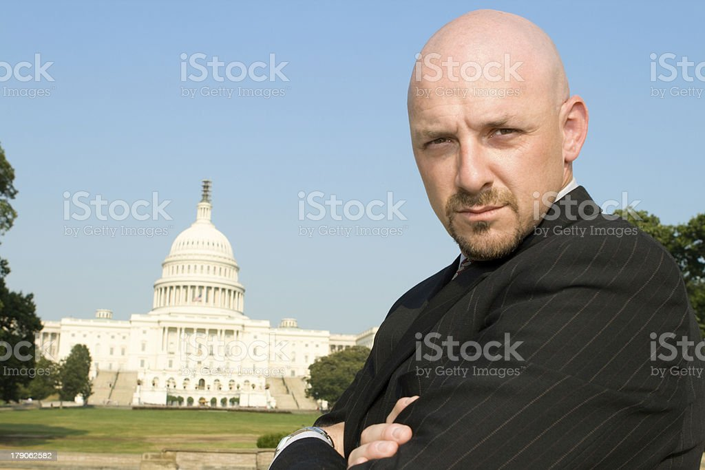 Powerful Caucasian Man Suit Arms Crossed Looking Camera, US Capitol royalty-free stock photo