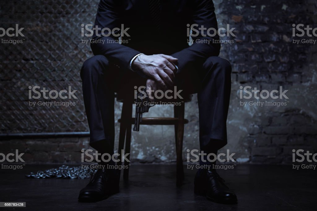 Powerful criminal posing with a pistol stock photo