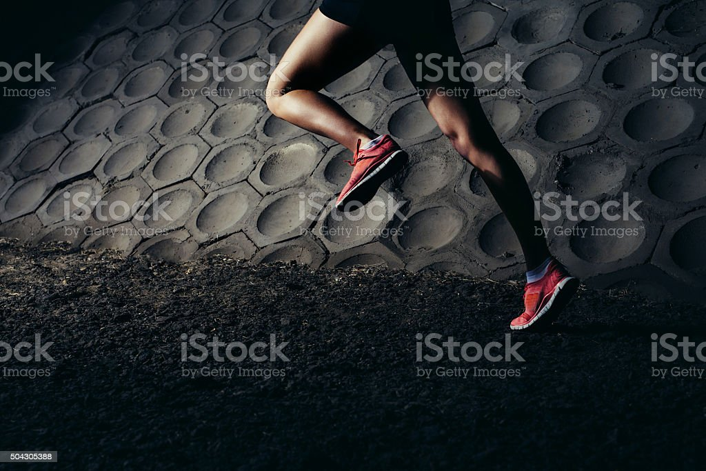 Powerful female runner stock photo