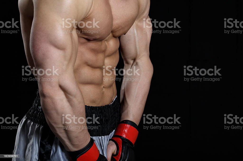Powerful fighter body part royalty-free stock photo