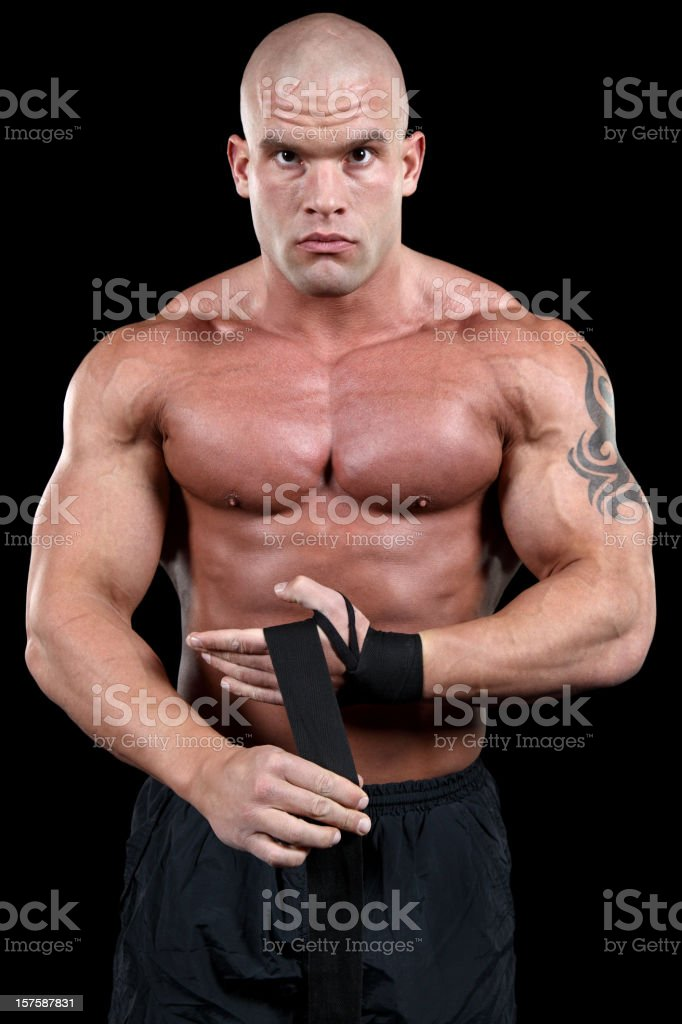Powerful fighter preparing for fight royalty-free stock photo