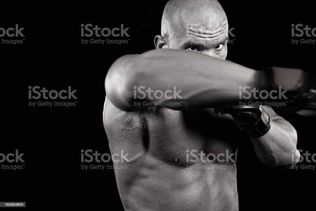 Powerful fighter punching royalty-free stock photo