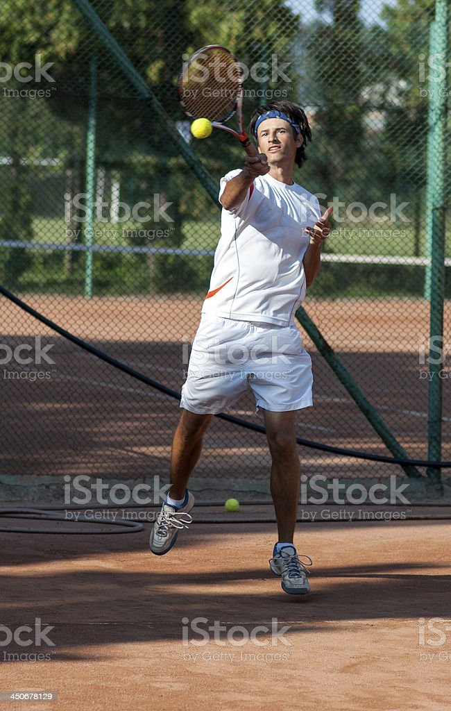 powerful forehand tennis royalty-free stock photo