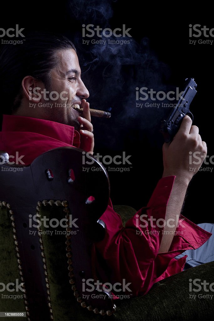 Powerful gang member sitting in armchair royalty-free stock photo
