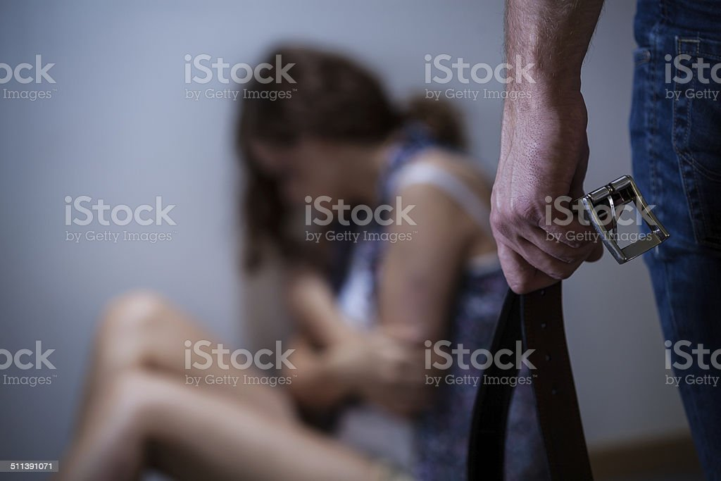 Powerful husband with a belt stock photo