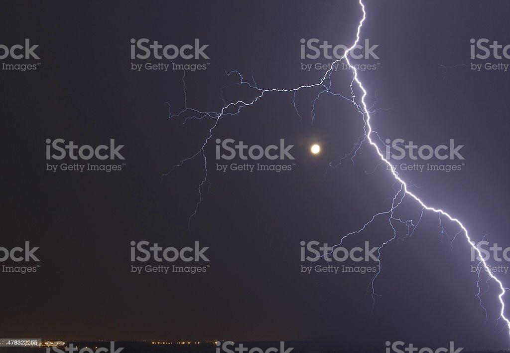 Powerful Lightning Bolt arround the Moon royalty-free stock photo