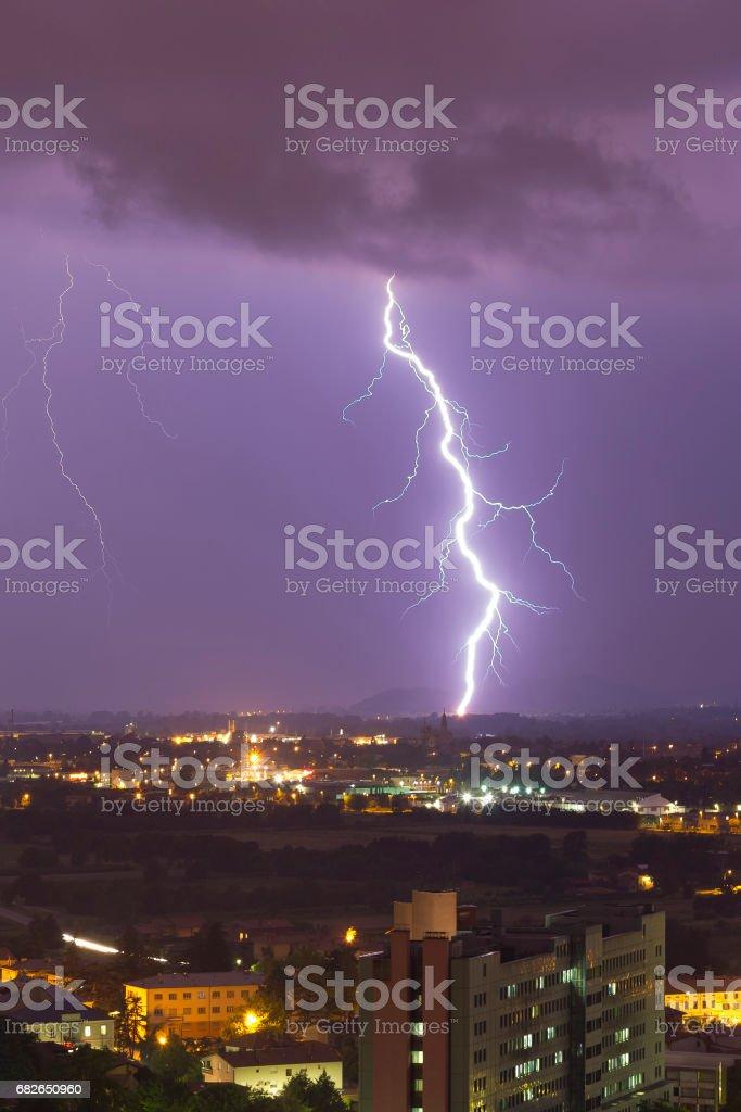 Powerful lightning bolt behind the city stock photo