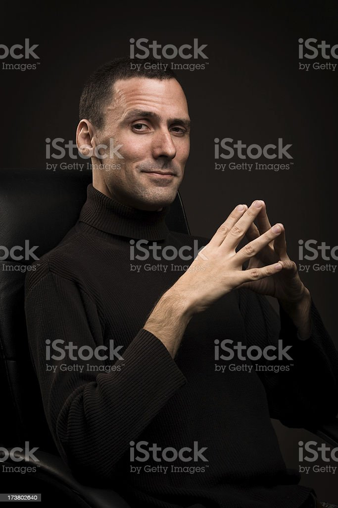 Powerful man giving an eye to camera royalty-free stock photo