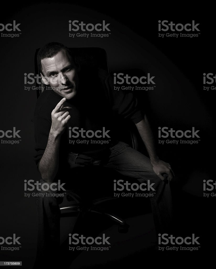 Powerful man in an office chair stock photo