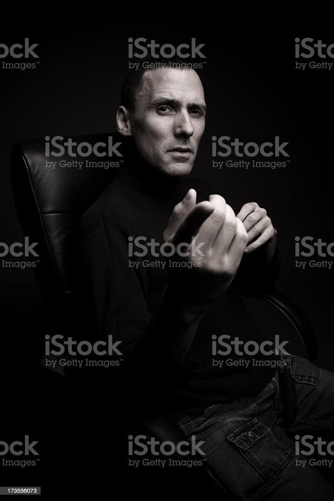 Powerful man in office chair stock photo
