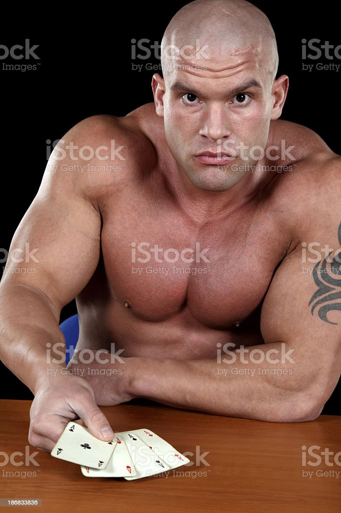 Powerful man playing poker royalty-free stock photo