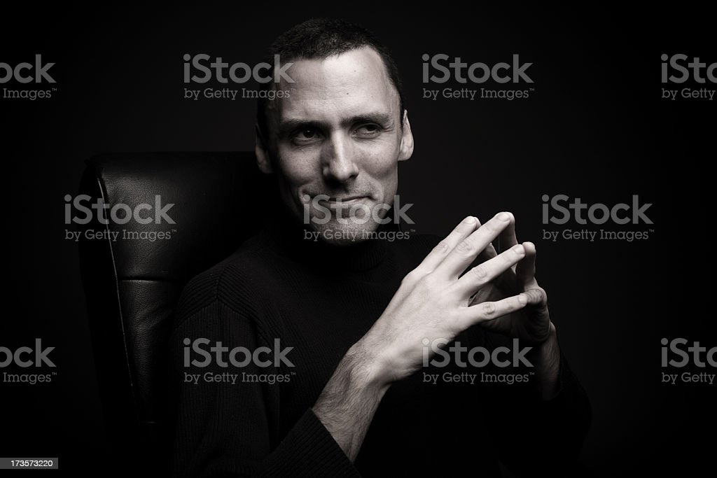 Powerful man sitting in office chair stock photo