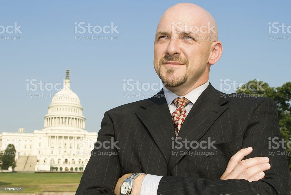 Powerful Man Suit Arms Crossed US Capitol Building Washington, DC stock photo