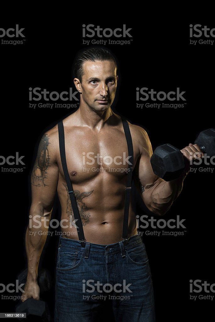 Powerful muscular man lifting weights royalty-free stock photo