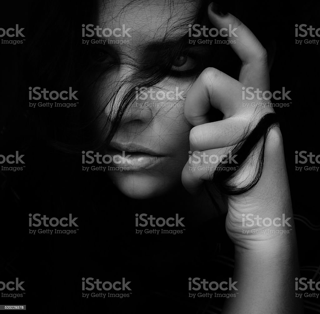 powerful portrait of woman thinking, close-up, alluring, tousled hair stock photo
