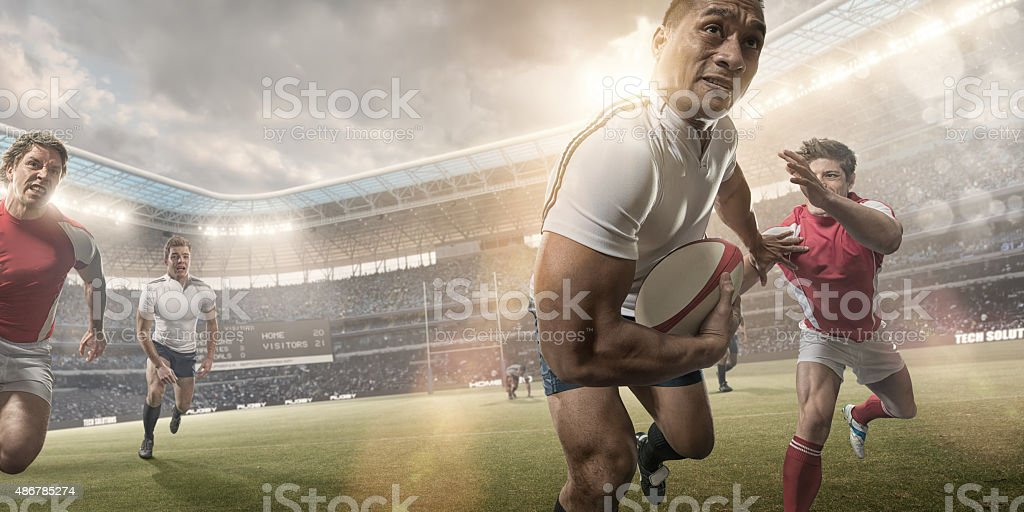 Powerful Rugby Player Hero During Rugby Match In Stadium stock photo