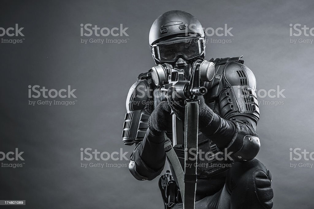 Powerful Soldier with Gas Mask and Bullet Proof Body Armor stock photo