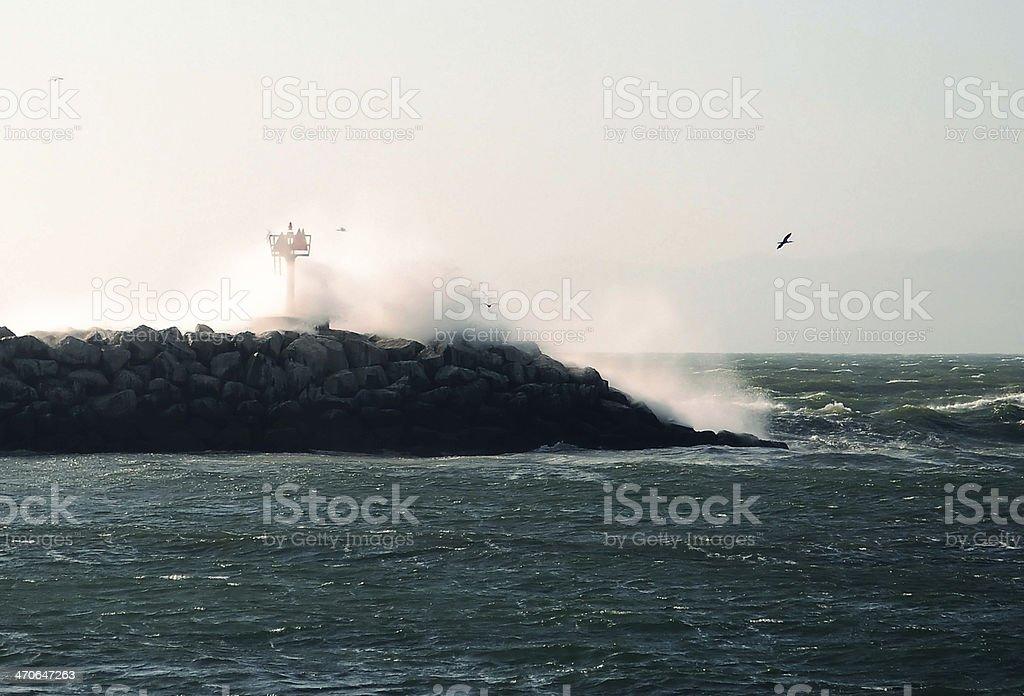 Powerful wave crashing over breakwater in California stock photo