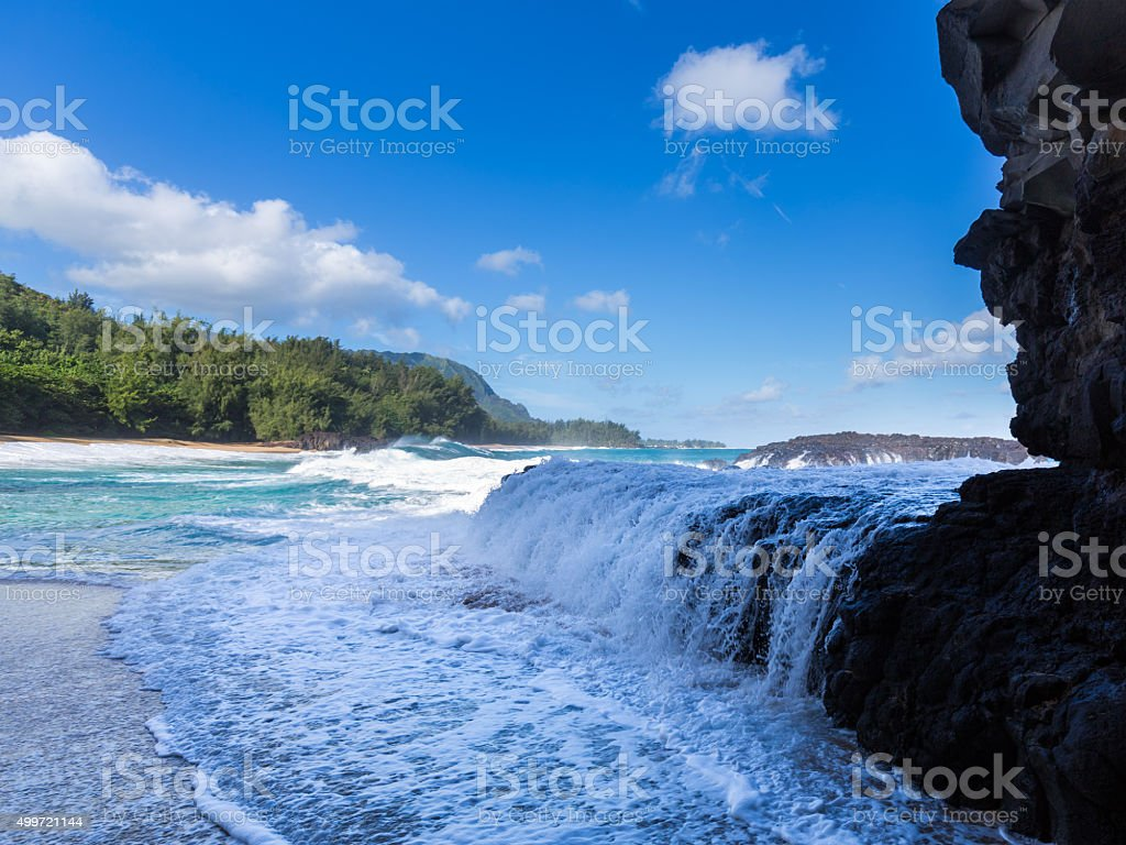 Powerful waves flow over rocks at Lumahai Beach, Kauai stock photo