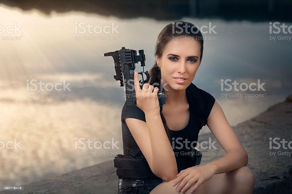 Powerful Woman Holding Gun Action Movie Style stock photo