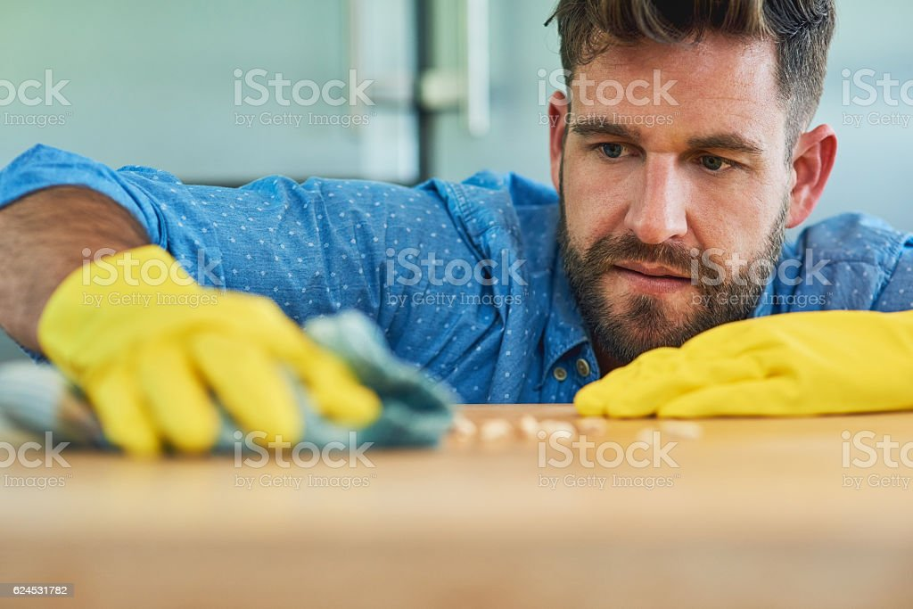 Powering through household chores like a champ stock photo