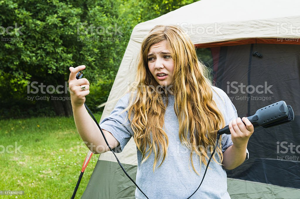 Powerless girl in camping with flat iron horizontal. royalty-free stock photo
