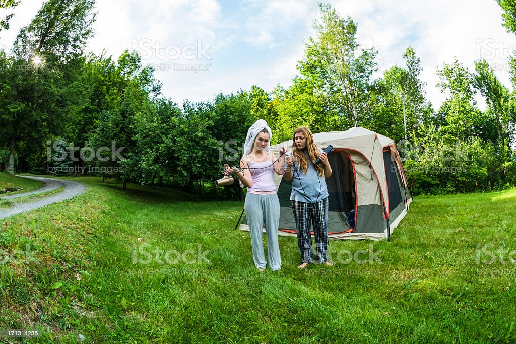 Powerless girls in camping with hairdryer and flat iron, fisheye. royalty-free stock photo