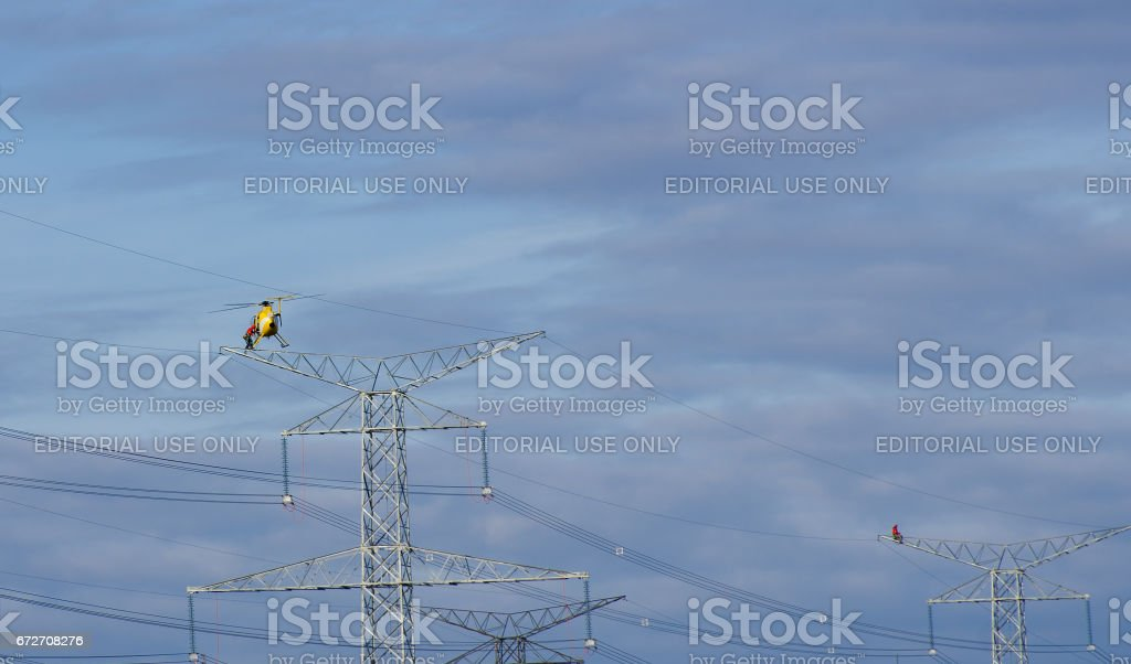 Powerline Construction Workers and Helicopter stock photo